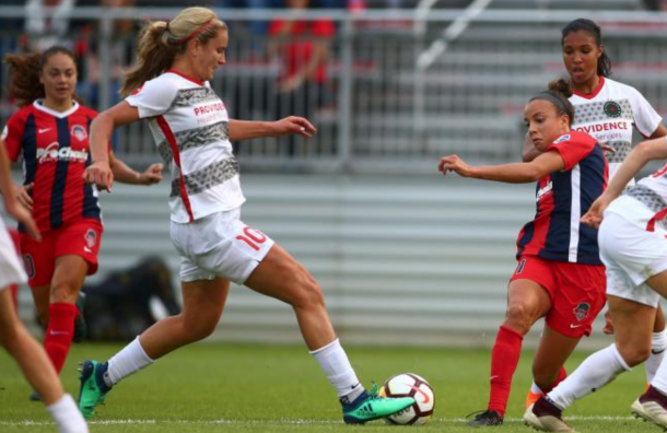 Portland Thorn Lindsey Horan (10) and Washington Spirit Mallory Pugh (11) battle for the ball (Photo: PortlandThorns.com)