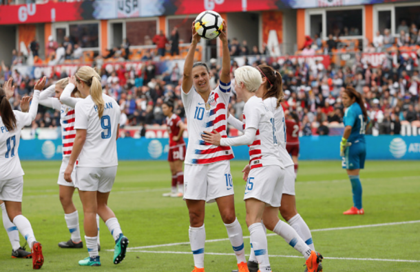 Carli Lloyd holds up the ball she scored her 100th career international goal for the USWNT. (Photo by Tim Warner/Getty Images)