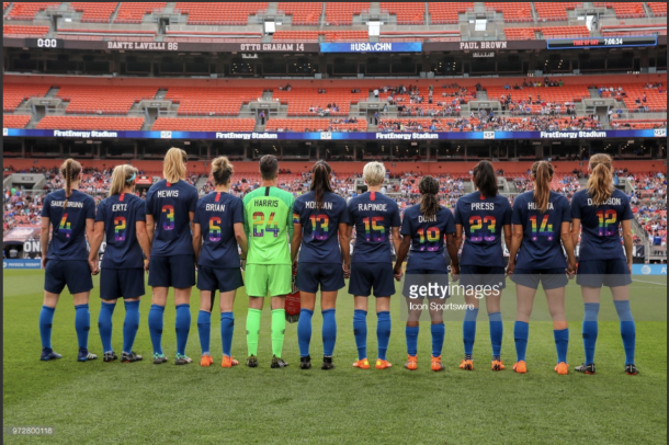 The National Team starters hold hands before the game in Cleveland, Ohio. Photo:Getty Images/IconSportswire