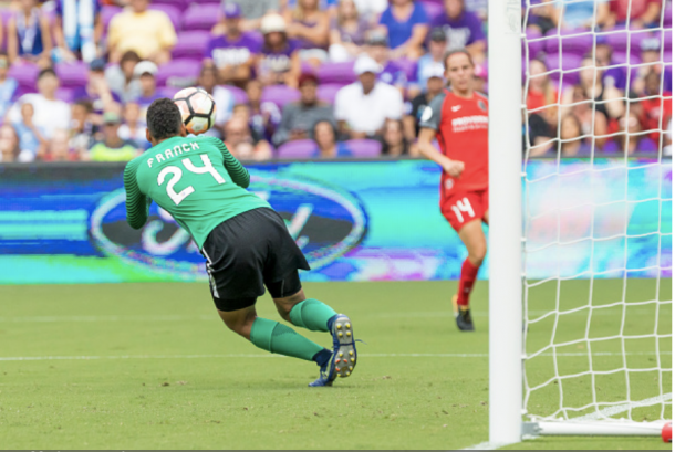 Franch lunges for the ball during a game against the Orlando Pride Image: Getty Images/IconSportswire