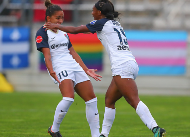 Debinha (left) registered a goal and an assist and Crystal Dunn (right) also registered an assist with 2 shots on goal. (Photo by Rich Graessle/Icon Sportswire via Getty Images)