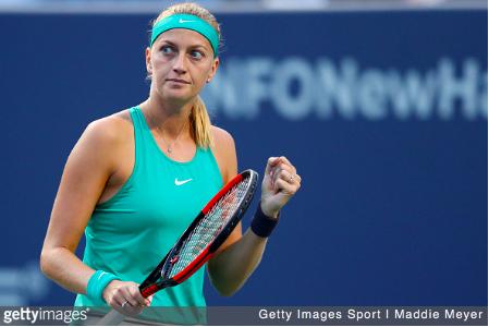 Kvitova celebrates after defeating Radwanska