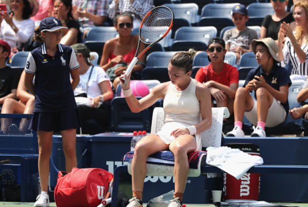 A frustrated Halep reacts during a changeover (Elsa/Getty Images)