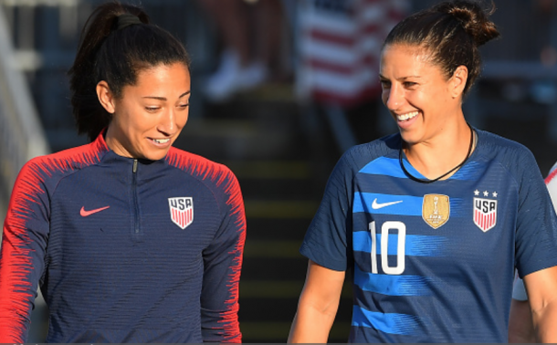 Christen Press (left) joins Carli Lloyd (right) in the 100 USWNT appearances club. (Photo by Rich Barnes/Getty Images)