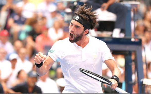 Basilashvili celebrates taking the third set over Nadal (Elsa/Getty Images)