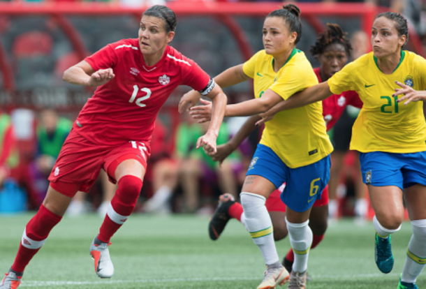 Portland Thorn FC Christine Sinclair of Canada battles against Orlando Pride players Camila (6) and Monica (21) of Brazil. (Photo by Sean Burges/Icon Sportswire via Getty Images)