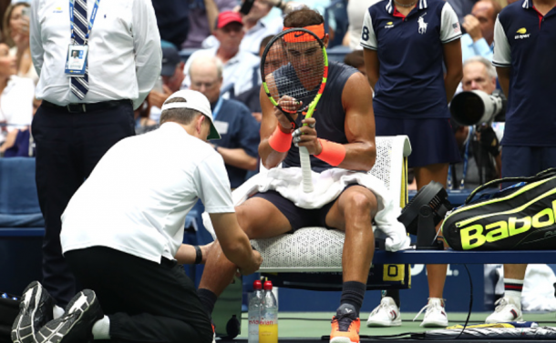 Nadal getting his knee taped up (Al Bello/Getty Images)