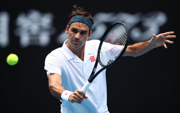 Federer was seen at the net often in this match (Cameron Spencer/Getty Images)