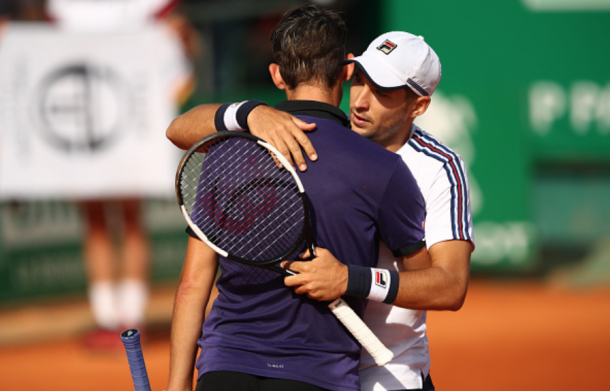 Lajovic and Thiem hug at the net after their match (Clive Brunskill/Getty Images)