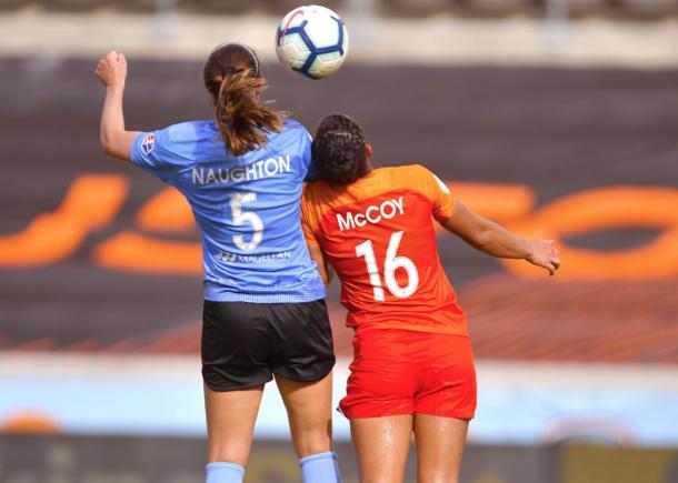 Chicago Red Star Katie Naughton (5) and Houston Dash Kayla McCoy (16) battle for a header. Photo: twitter.com/HoustonDash