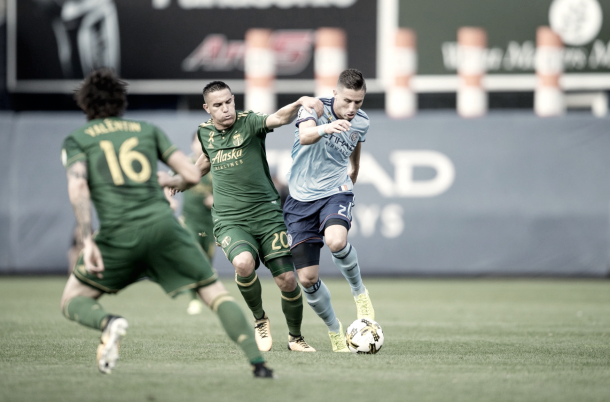 Ben Sweat and David Guzmán fighting for possession in the second half. | Photo: New York City FC