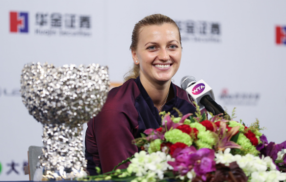 An elated Kvitova speaks to the press after her triumph in the final. Photo credit: VCG/Getty Images.