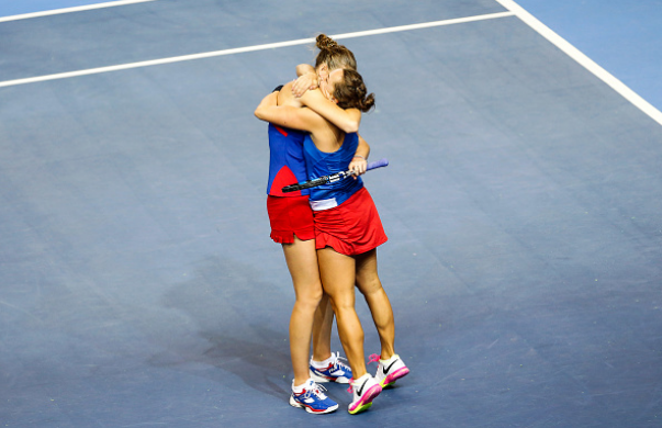 Pliskova (left) and Strycova (right) hug after defeating Garcia and Mladenovic to seal Czech Republic's third Fed Cup title in a row, its fifth in the last six years. Photo credit: Fred Marvaux/Getty Images.