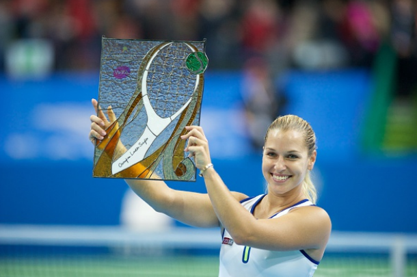 Cibulkova lifts the Katowice Open trophy. Photo credit: Gallao Images/Getty Images.