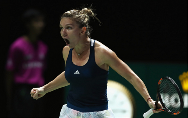 Simona Halep exploding with joy after wining a point | Photo: Julian Finney/ Getty Images