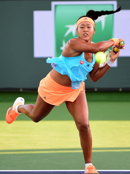 Naomi Osaka in her first round match against Risa Ozaki | Photo: harry How / Getty Images