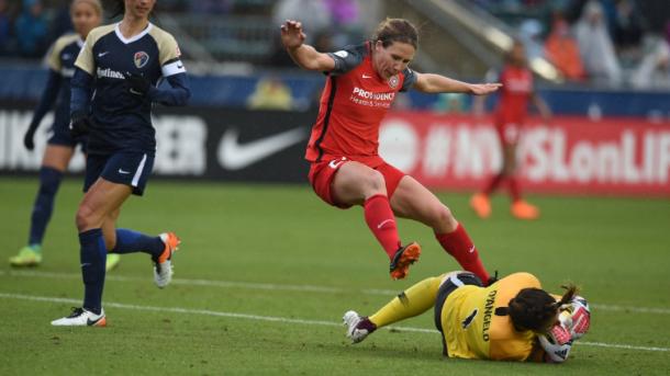 Courage goalkeeper Sabrina D'Angelo blocks an attack from Portland forward Mallory Webber.   Photo: @ThornsFC