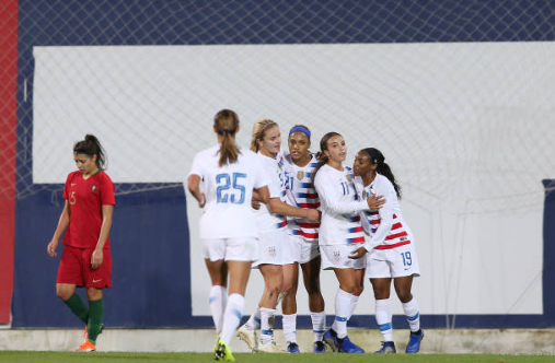 Jessica McDonald (center) is congratulated after scoring her first career goal for the United States. | Photo: Gualter Fatia - Getty Images