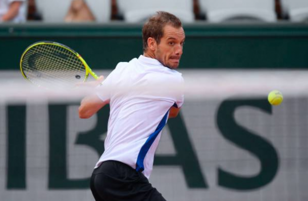Richard Gasquet strikes a backhand shot (Photo: Lionel Bonaventure/Getty Images)