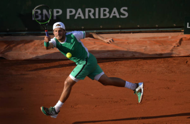 Lucas Pouille stretches for a forehand shot (Photo: Aurelien Meunier/Getty Images)