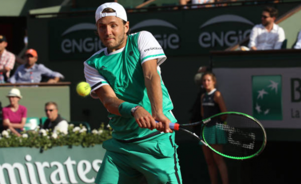 Lucas Pouille strikes a backhand shot during his second round match (Photo: Aurelien Meunier/Getty Images)
