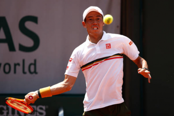 Kei Nishikori returning a shot (Photo: Adam Pretty/Getty Images)