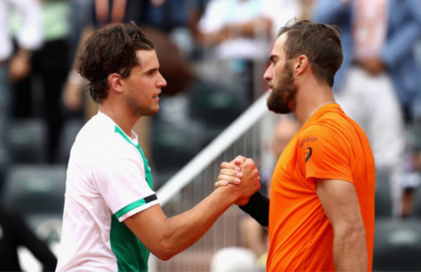 Dominic Thiem showing tremendous sportsmanship at the net to Steve Johnson (Photo: Julien Finney/Getty Images)