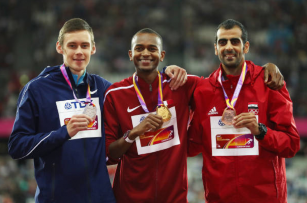 The three medalists Mutaz Essa Barshim, Danilo Lysenko and Majededdin Ghezal pose for pictures on the podium (Photo: Richard Heathcote/Getty Images)