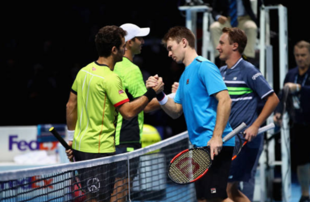 Jean-Julien Rojer and Horia Tecau shake and congratulate Henri Kontinen and John Peers on their win (Photo: Clive Brunskill/Getty Images)