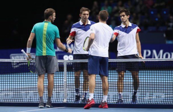 Pierre-Hugues Herbert and Nicolas Mahut congratulate Ryan Harrison and Michael Venus at the net (Photo: Clive Brunskill/Getty Images)