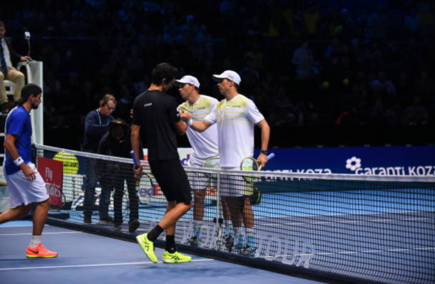 Bob and Mike Bryan congratulate Lukasz Kubot and Marcelo Melo on qualifying (Photo: Glyn Kirk/Getty Images)