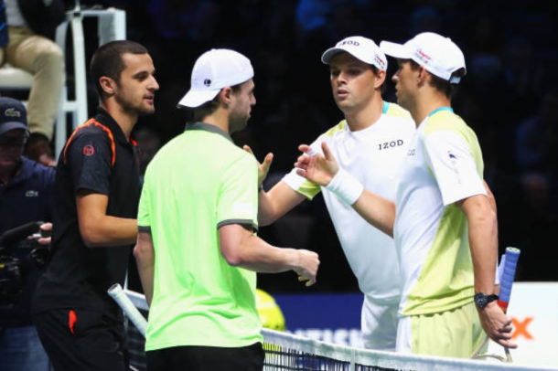 Bob and Mike Bryan shake hands with Oliver Marach and Mate Pavic (Photo: Clive Brunskill/Getty Images)