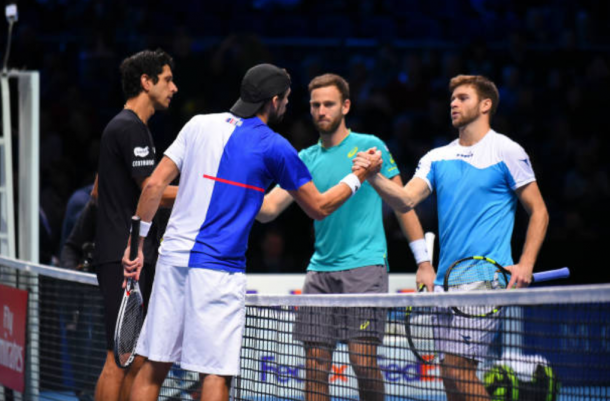 Ryan Harrison and Michael Venus congratulate Lukasz Kubot and Marcelo Melo (Photo: Julian Finney/Getty Images)