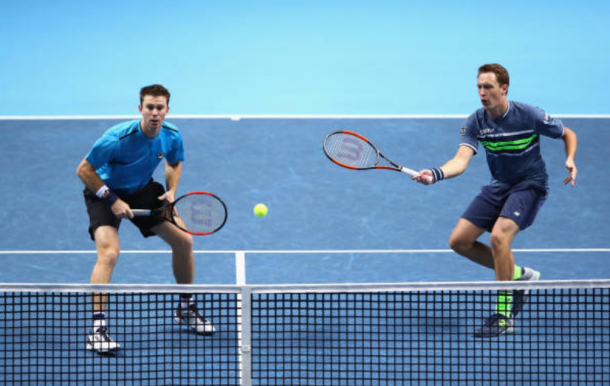 Henri Kontinen and John Peers play a return shot (Photo: Clive Brunskill/Getty Images)