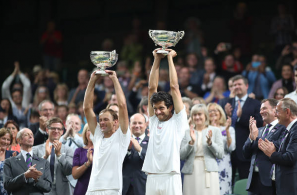 Lukasz Kubot and Marcelo Melo cannot believe they've won the Wimbledon title (Photo: Rob Foldy/Getty Images)