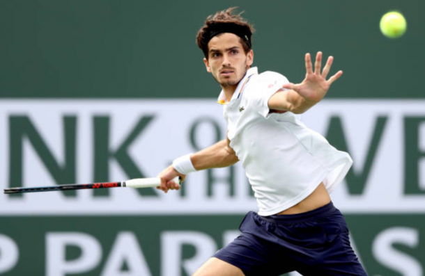 Pierre-Hugues Herbert gears up to strike a forehand shot (Photo: Matthew Stockman/Getty Images)