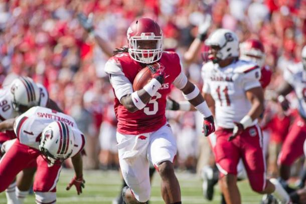 Arkansas running back Alex Collins carries the ball in a game against South Carolina. Image via Beth Hall/USA TODAY Sports