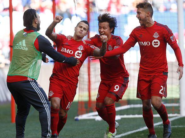 Sebastian Giovinco (red, #10) celebrating with teammates after scoring a goal. Photo credit: Jeff Zelevansky/Getty Images Sport