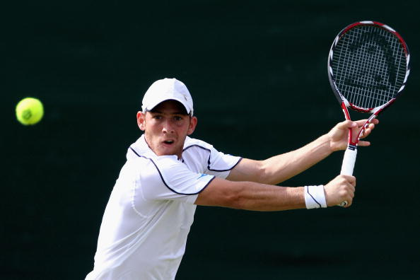 Sela plays a backhand during the men's singles third round match against Tommy Robredo of Spain on Day Five of the Wimbledon Lawn Tennis Championships at the All England Lawn Tennis and Croquet Club on June 26, 2009 in London, England (Photo by Hamish Blair/Getty Images