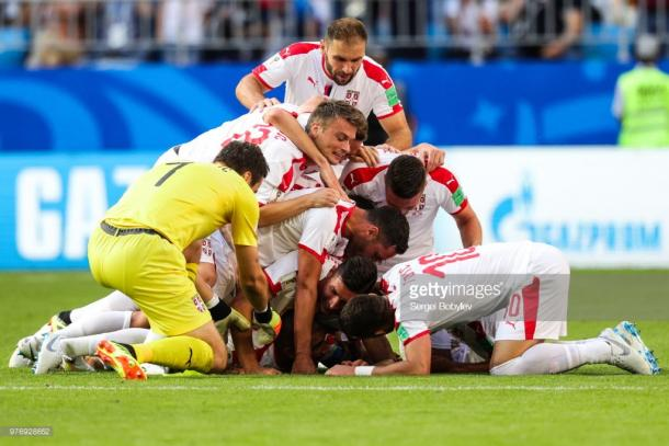 Serbian players celebrate the opening goal. Source | Getty Images.