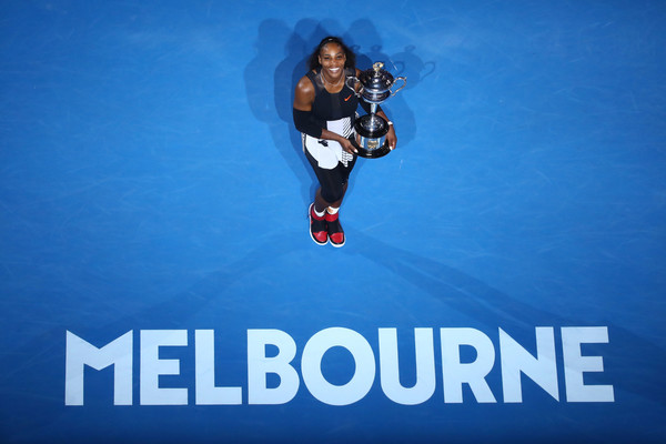 Serena Williams poses with the Daphne Akhurst Memorial Cup after defeating Venus Williams in the final of the 2017 Australian Open. | Photo: Cameron Spencer/Getty Images