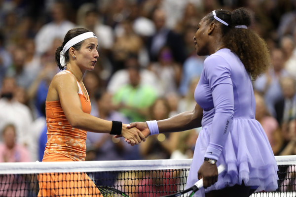 Williams and Sevastova meet at the net after the match | Photo: Matthew Stockman/Getty Images North America