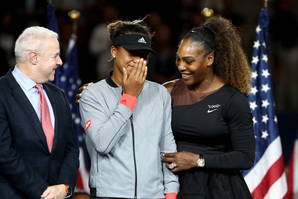 Serena Williams comforts Naomi Osaka, who was crying both tears of joy and sadness, during the trophy ceremony after the crowd booed to show their discontentment over some of umpire Carlos Ramos' decisions. | Photo: Julian Finney/Getty Images