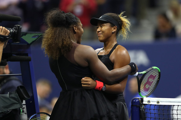 Serena Williams and Naomi Osaka share a nice moment at the net after their 2018 U.S. Open women's singles final. | Photo: Matthew Stockman/Getty Images