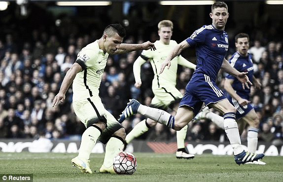 Above: Sergio Aguero scoring his second in Chelsea's 2-0 defeat to Manchester City