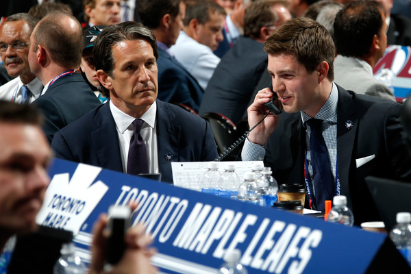 Shanahan (left) and assistant GM Kyle Dubas (on the phone) at the 2015 Entry Draft, where they took Mitch Marner 4th overall. Photo: Bruce Bennett/Getty Images