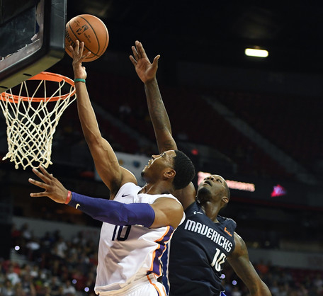 Shaquille Harrison #10 of the Phoenix Suns drives to the basket against Dorian Finney-Smith #10 of the Dallas Mavericks. |Ethan Miller/Getty Images North America|