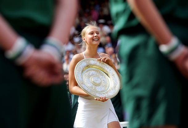 Maria Sharapova smiles after winning her first Grand Slam final in Wimbledon 2004. (Photo by Mike Hewitt/Getty Images)