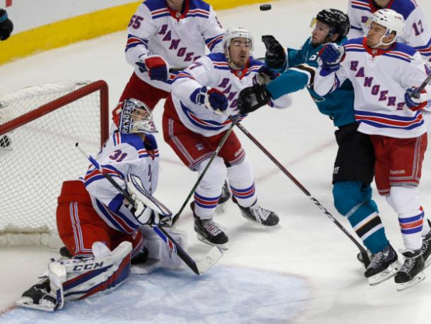 New York Rangers' goalie Ondrej Pavelec tries to follow the puck towards his net. (Photo: Mercury News)