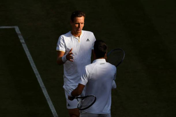 Tomas Berdych and Novak Djokovic meet at the end of the match (Getty/Shaun Botterill)